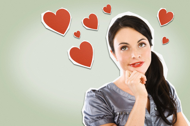 Young Woman Surrounded by Heart Shapes