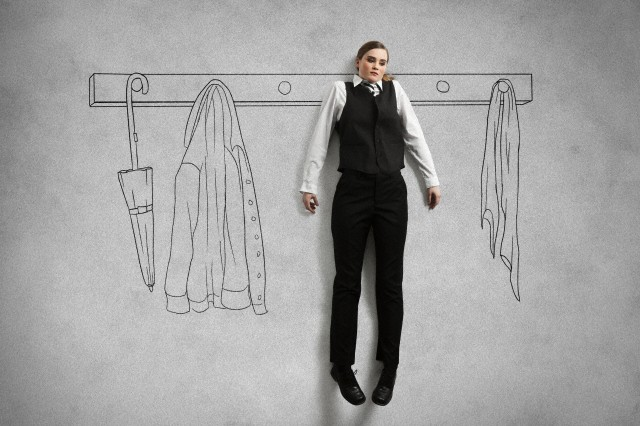Business woman hanging on wardrobe