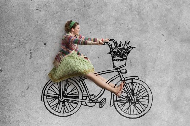 Young women riding drawing bicycle