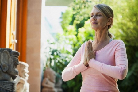 Middle-aged woman in yoga pose.