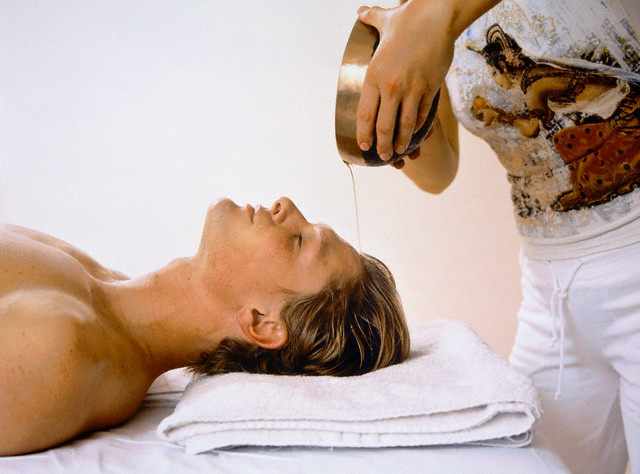 Young Man Receiving Ayurveda Treatment