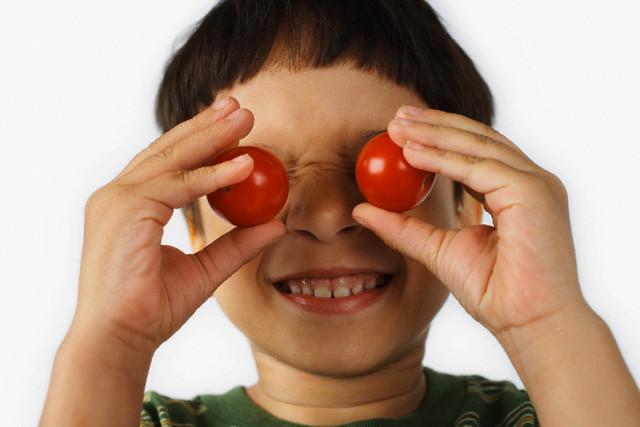 Boy Holding Cherry Tomatos