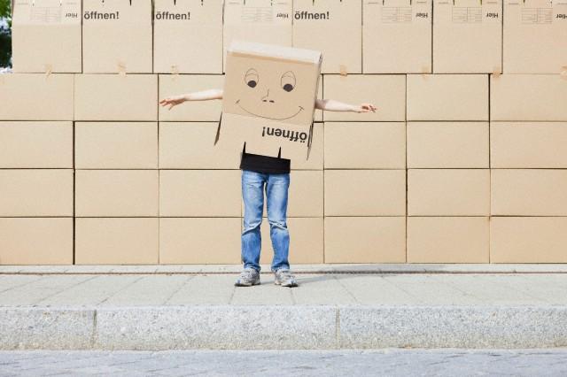 Man wearing cardboard box covering his head