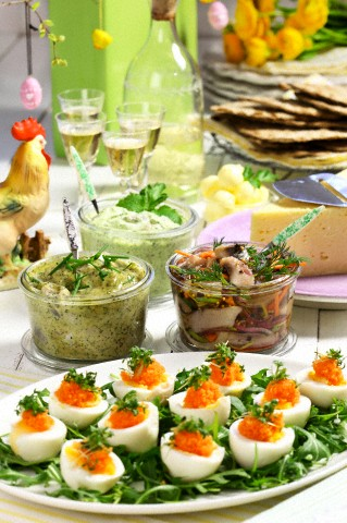 Close-up of pickled herring and eggs at Easter table